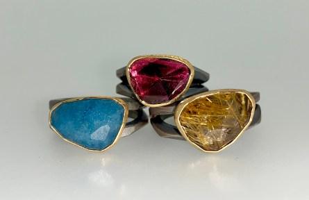 Split band rings, 22k gold, l. to r.; lazulite, pink tourmaline, Gold ruitilated quartz