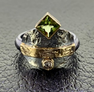 Oxidized sterling, 14k gold, peridot, diamond.