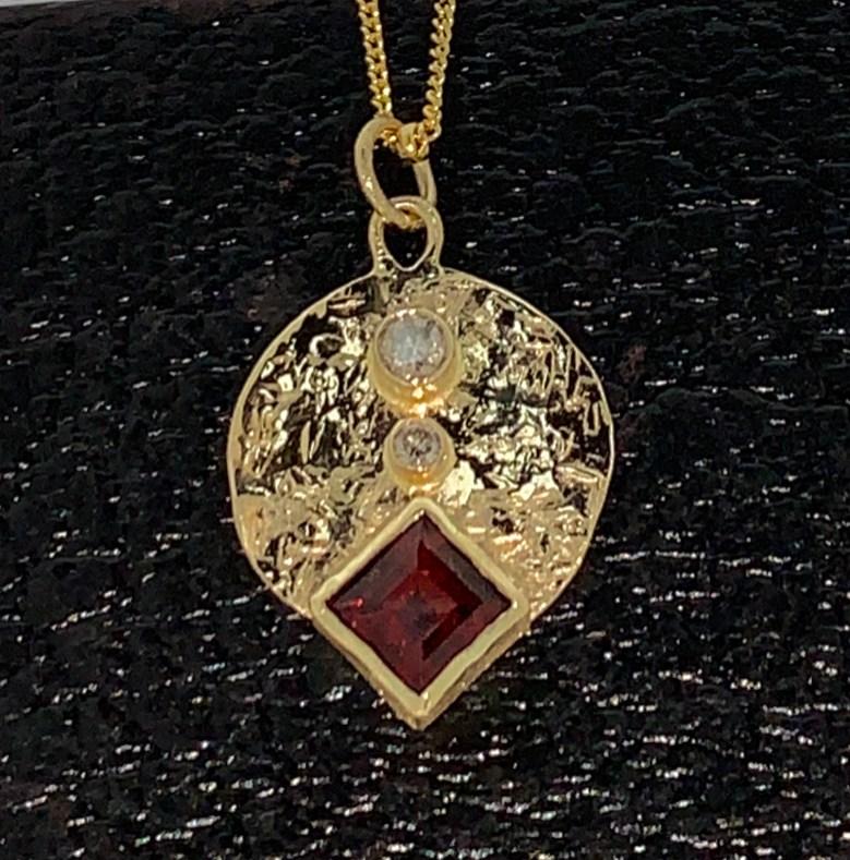 14k gold, 6mm princess cut Mozambique garnet, diamonds.