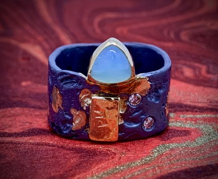 Peruvian blue opal in 14k gold with diamonds and oxidized sterling