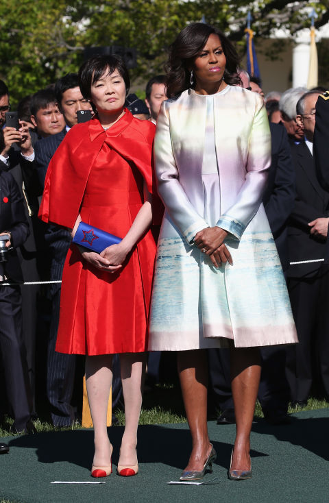 She wears a matching Monique Lhuillier pastel coat and dress with the First Lady of Japan, Akie Abe, welcoming the Japanese Prime Minister and his wife to the White House.