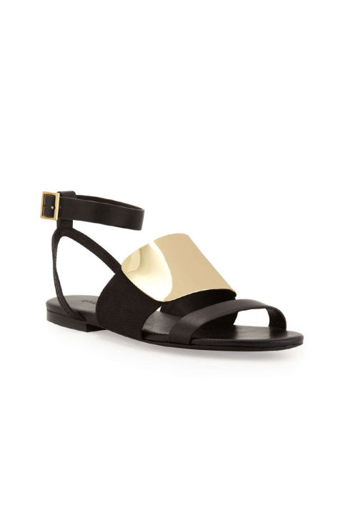 """I have these in the sold out block heel version, but the flat version works much of the same magic: a sandal that takes 2 seconds to put on, is covered enough that it feels like a proper, substantial shoe, and looks much more expensive than it is. I wear mine with simple black and white summer dresses and feel instantly more polished once they're on my feet."" See by Chloé Metal Vamp Flat Sandal, $342; couturecandy.com"