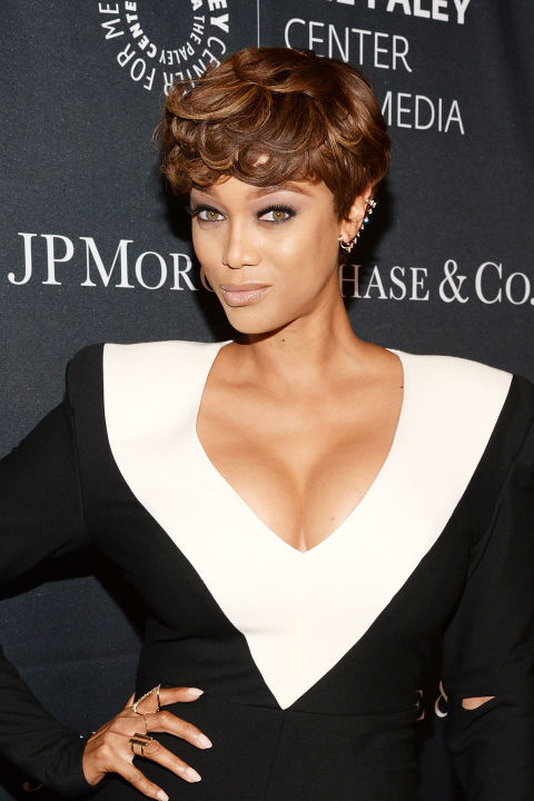 We're digging Tyra Banks short take on little orphan Annie's auburn curls.