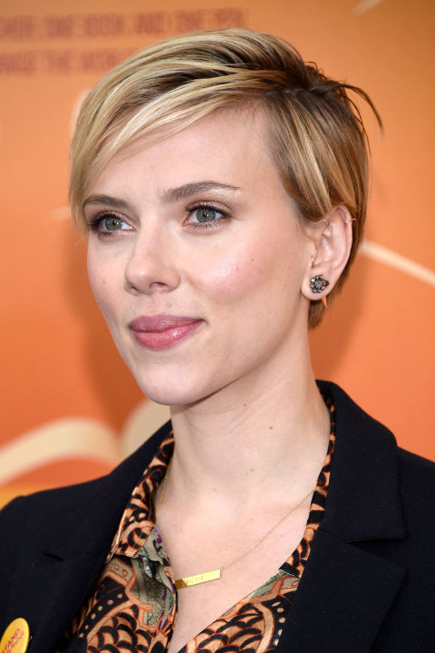 Scarlett Johansson gives her cut a deep side part and casually sweeps it across her forehead.