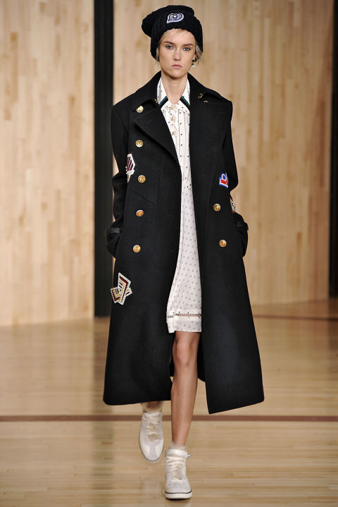 Last winter, we were obsessed with the camel coat. It was an easy piece that matched denim, evening wear, and everything in between. And though we're still in love with them, we think the neutral-outerwear has met its match with this season's Navy-inspired overcoat. As seen at Coach, the gold-buttoned coat is just as versatile, but a bit more dramatic.