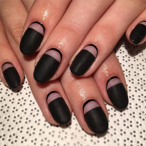 Or, reverse the design of the last nail for this design. Start by taping off your half moon. Add a matte black polish and wait to dry. Remove the tape, then outline the base of your nail in the same color. Design by @rosebnails