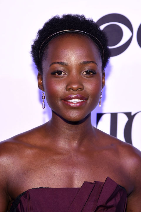 Lupita Nyong'o wears her short curls pushed back with a chic headband.