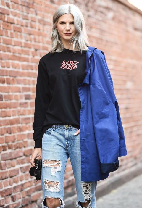 Basic tees were one of the most dressed-down trends spotted outside the shows. Whether vintage or paying homage to a pop star, there's a version for everybody.