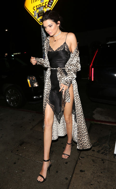 In a black lace slip dress with a thigh-high slit and silk leopard-print robe while out in West Hollywood.