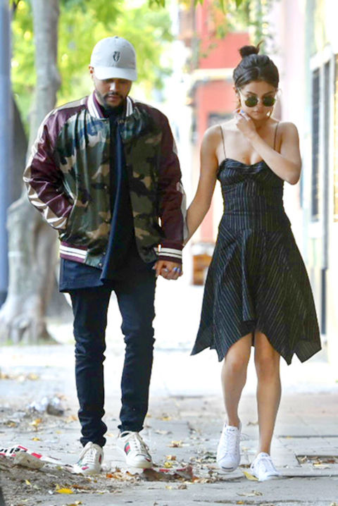 In an Isabel Marant dress with Converse x Jack Purcell sneakers while out on a date withThe Weeknd inBuenos Aires.