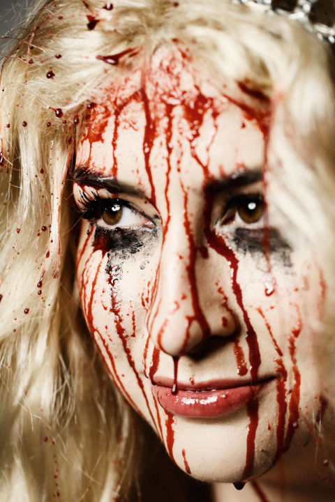 Complete the blood-soaked Carrie look with an askew tiara, vengeful eyes, and a demented smirk!