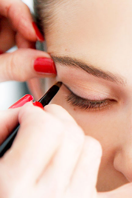 """When you want to enhance your eyes, you should use a dark liner—navy, charcoal, brown, or black—to contrast against the whites of your eye and your eye color,"" says Linter. ""You should also use pencil because it's easily manipulated. Liquids and gels will chip and flake, but pencil can be pushed around to form a beautiful shape."" Linter opted for Lancôme Le Crayon Khôl in Black Coffee and applied it along the upper lash line in ""little dashes,"" working from the inner corner of the eye to the outside edge. ""The shape should get gradually thicker as you move away from the nose,"" she says. Lancôme Le Crayon Khôl in Black Coffee, $25.50; neimanmarcus.com"