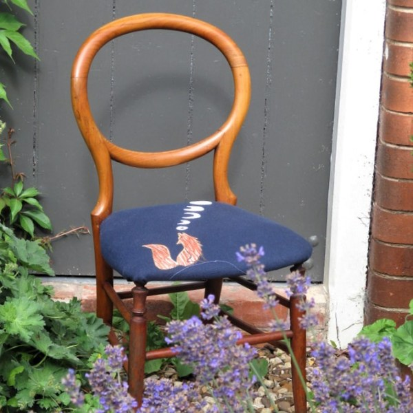 Bedroom chair with howling fox applique design