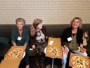 Pizza-eters in het Rijksmuseum. Dinner aangeboden door Sterren op het Doek