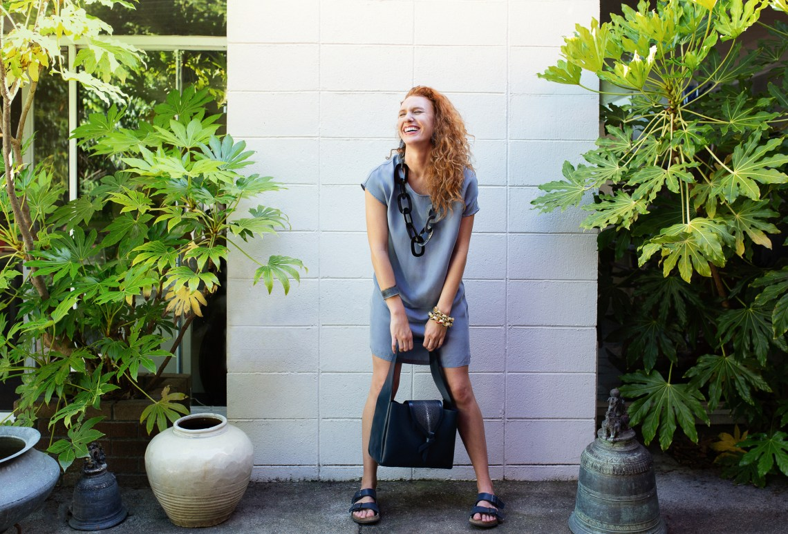Laughing woman with Vivo handbag, lifestyle photography by Ella Sophie, Marin CA
