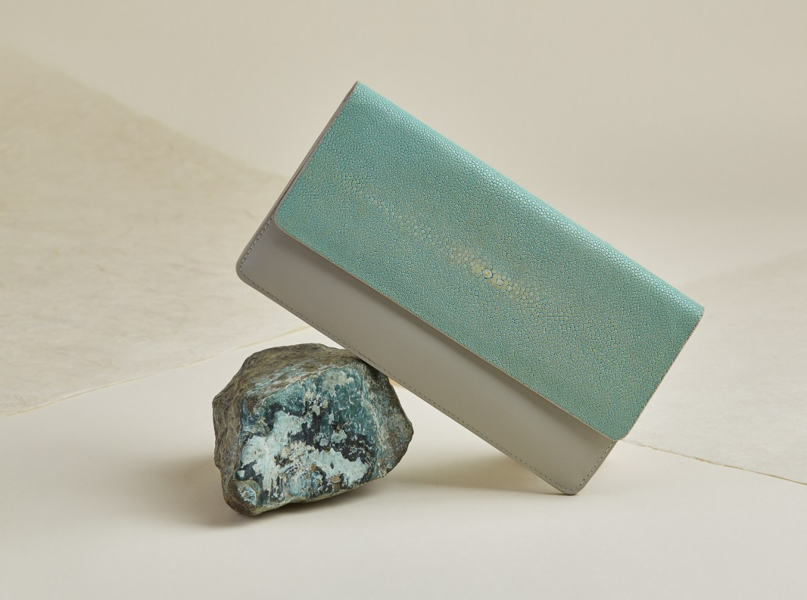 shagreen & leather clutch product photo with teal rock by Oakland photographer Ella Sophie