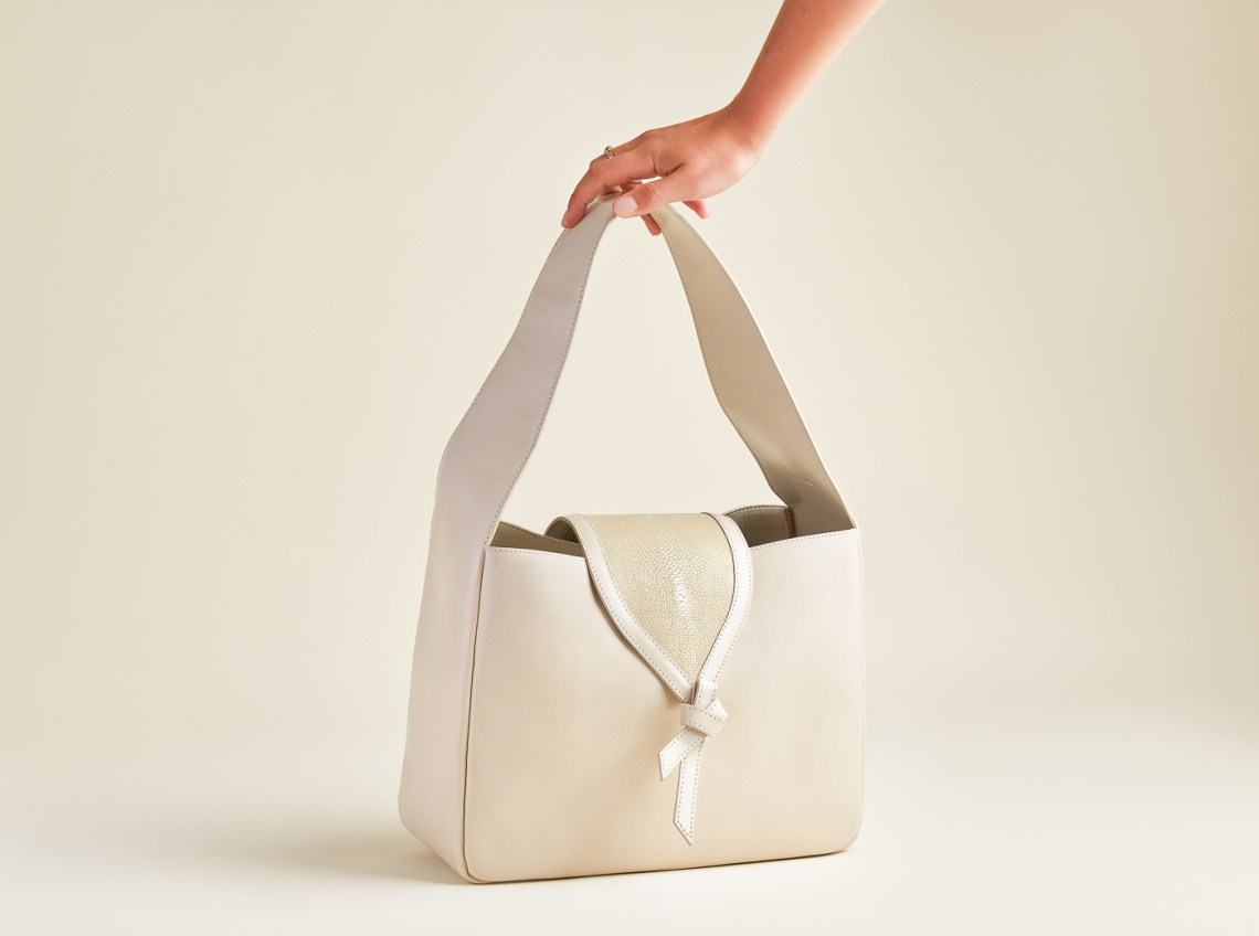 cream leather bag with neutral background, product photographers San Francisco Bay Area, Ella Sophie