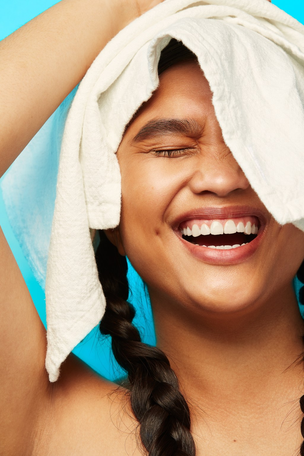 Beauty portrait of woman laughing with linen laundry by San Francisco Photographer Ella Sophie