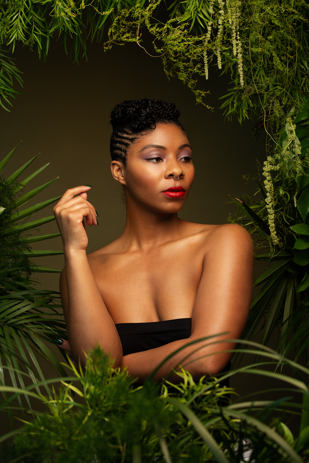 Empowered black woman's portrait with green plant set by Oakland photographer Ella Sophie