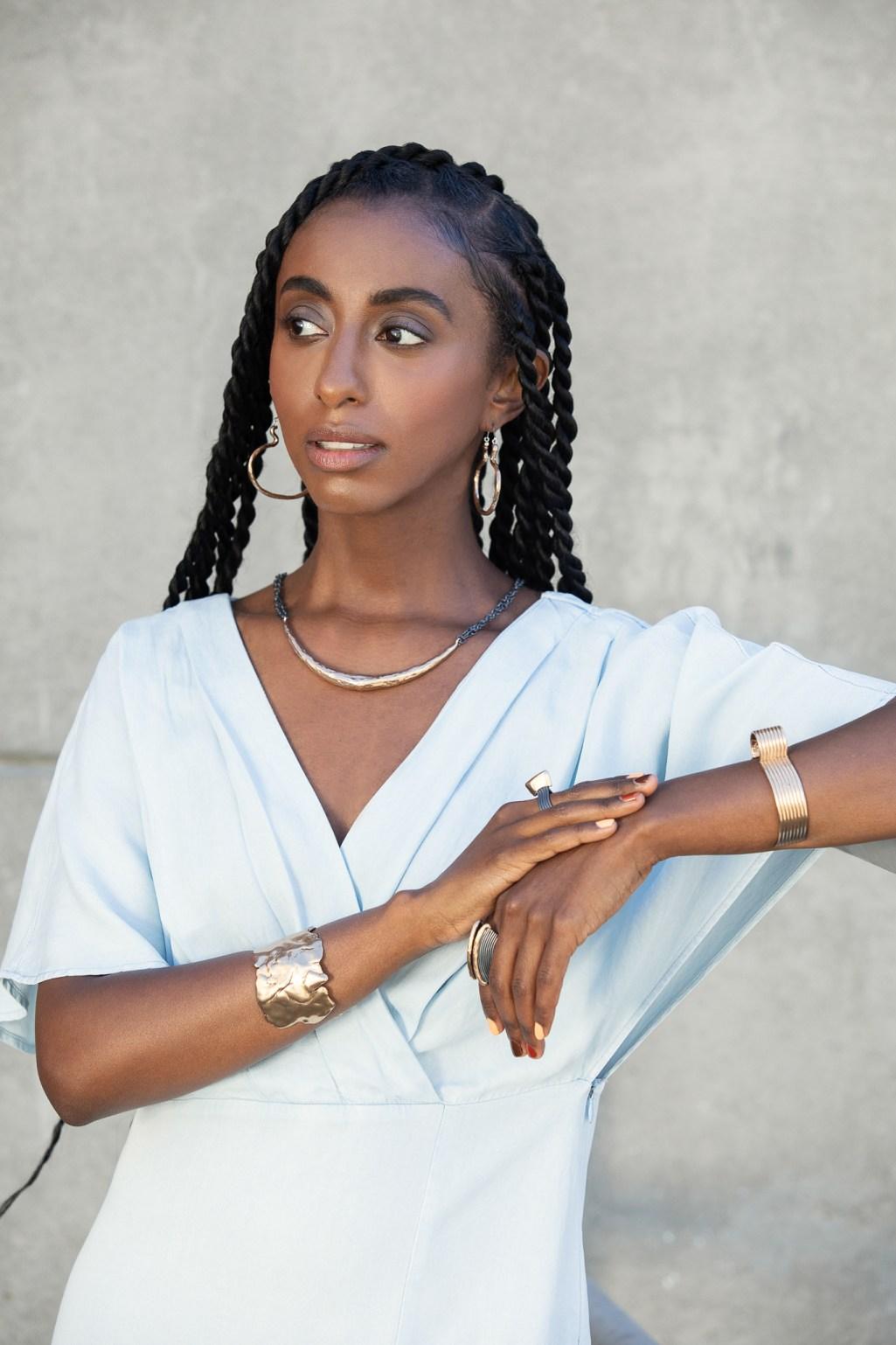 Portrait of Kalkidan Gebreyohannes showing bronze ethical jewelry. By Oakland photographer Ella Sophie