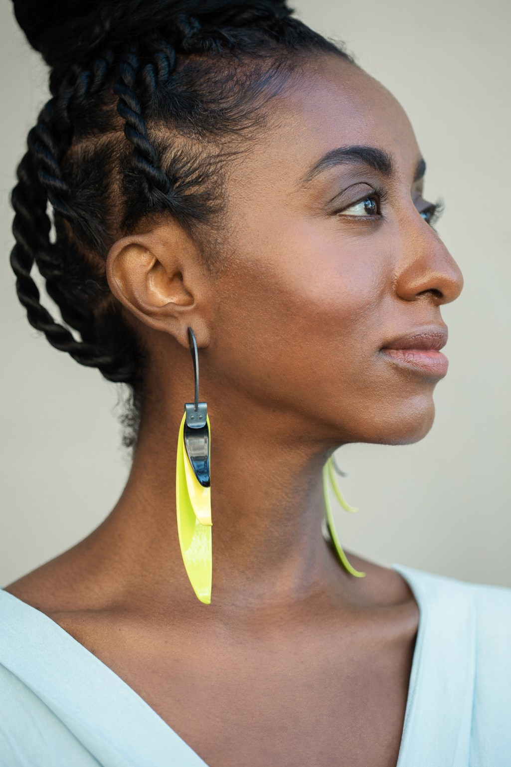 Jewelry photography with yellow metal earrings modeled by Kalkidan Gebreyohannes in lifestyle shoot by Ella Sophie. Oakland