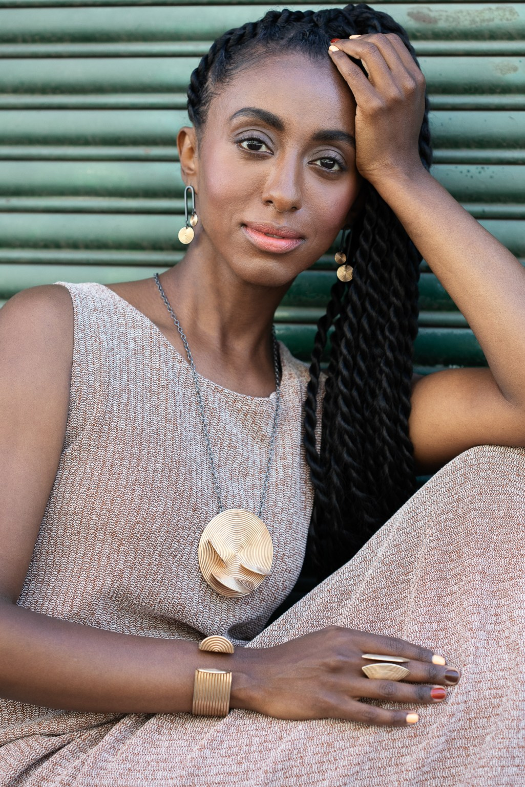Branding photography for Oakland Jewelry Designer. Confident black woman posing with bronze jewelry.