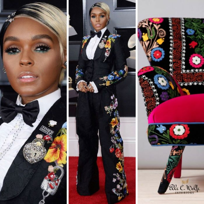 Singer Janelle Monae on the red carpet at the 60th Grammy Awards with black floral embroidered tuxedo and an embroidered chair