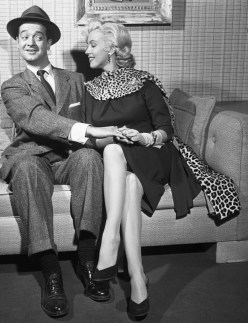 """28 Nov 1952 --- In 1953, the late Marilyn Monroe proved to be a masterful teacher as she taught newcomer Tommy Noonan how to make love in the movie """"Gentlemen Prefer Blondes."""" Ten years later Noonan was starring in his own production of """"Promise Her Anything"""" with another blonde sex goddess, Jayne Mansfield. The pictures speak for themselves about Tommy's struggles against designing women. --- Image by © Bettmann/CORBIS"""