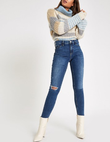 River Island, Mid Blue Pearl Raw Hem Molly Jeggings. Sizes UK 6 - 18. £42.00. https://www.riverisland.com/p/plus-blue-molly-pearl-button-mid-rise-jegging-724870