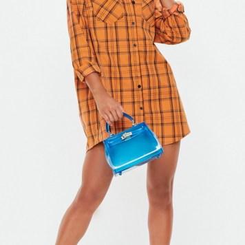 Orange Oversized Checked Shirt Dress. Sizes UK 4 - 16. £25.00. https://www.missguided.co.uk/orange-check-oversized-shirt-dress-10127241