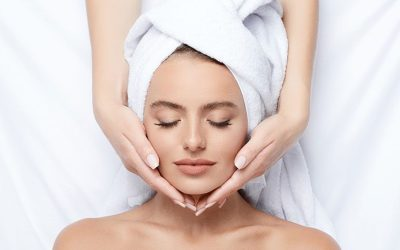 woman receiving facial eyes closed acne facial ellemes medical spa atlanta