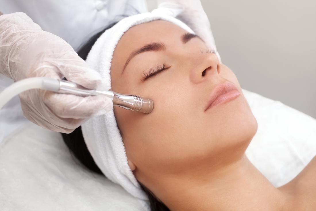 lady with eyes closed receiving microdermabrasion treatment ellemes medical spa atlanta