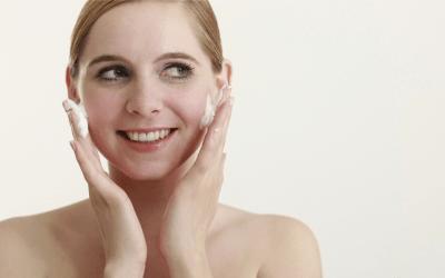 woman smiling cleansing face atlanta medical spa