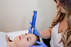 woman receiving microneedling treatment at Ellemes Medical Spa in Atlanta, GA