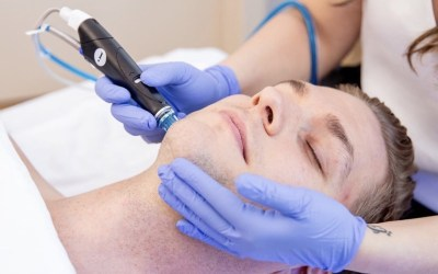 male receiving hydrafacial treatment at Ellemes Medical Spa in Atlanta, GA