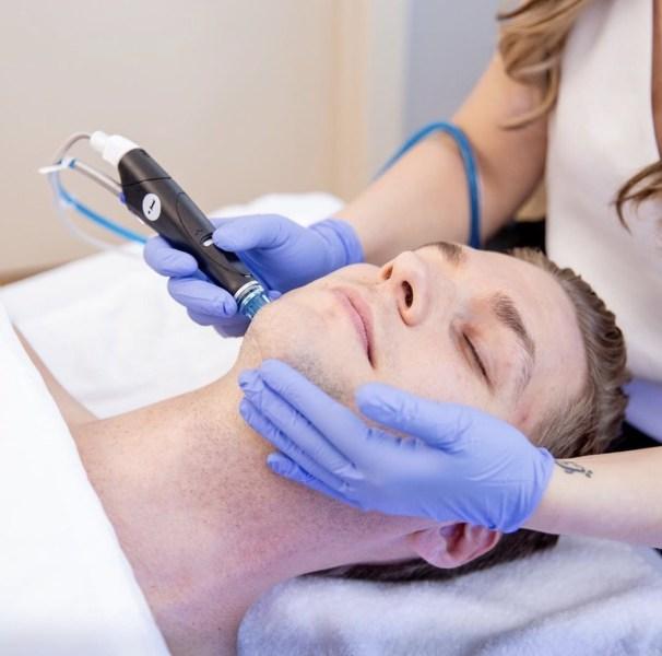 male receiving hydrafacial treatment at Ellemes Medical Spa in Atlanta, GA