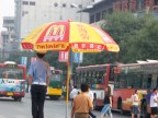 I laughed to see a McDonald's umbrella sheltering the traffic police.