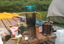 My camping set-up includes the BioLite stove (using wood for fuel, along with the BioLite KettlePot, and an MSR nested pot and cooking set. Everything fits is one pail, along with a hatchet.