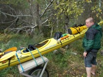 Solo kayaker heading home