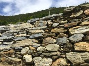Getting the right kind of stone for walls is crucial, for stability, but also for appearances - as some mistakes with gray rock from elsewhere have made clear