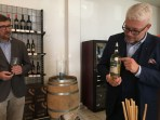 CEO Martin Wiederkehr shows how you can peel off the small label with the pre-Belles Filles name