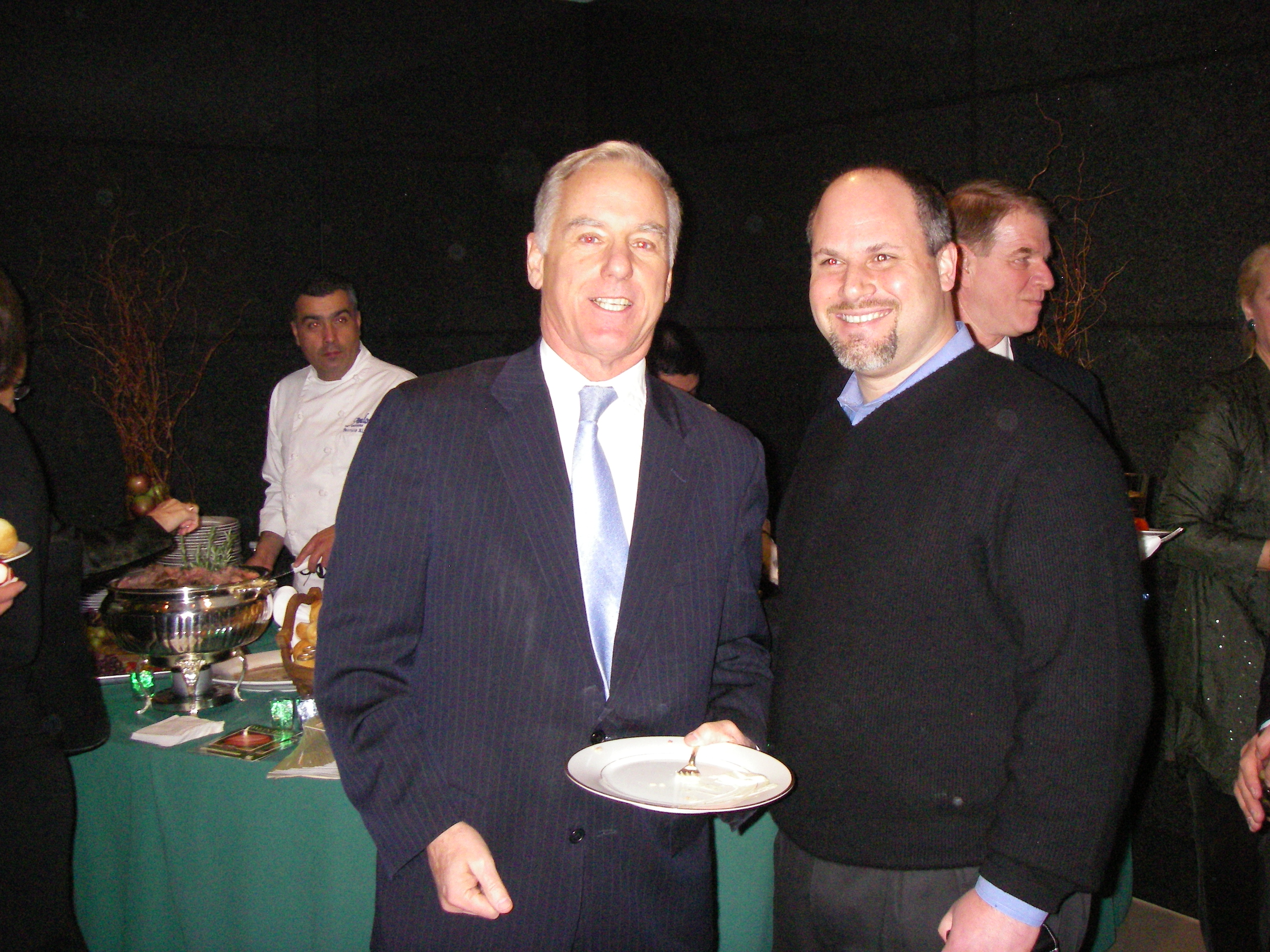 Howard Dean (on the left), at the Vermont State Society Reception