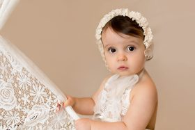 one year old girl with bonnet