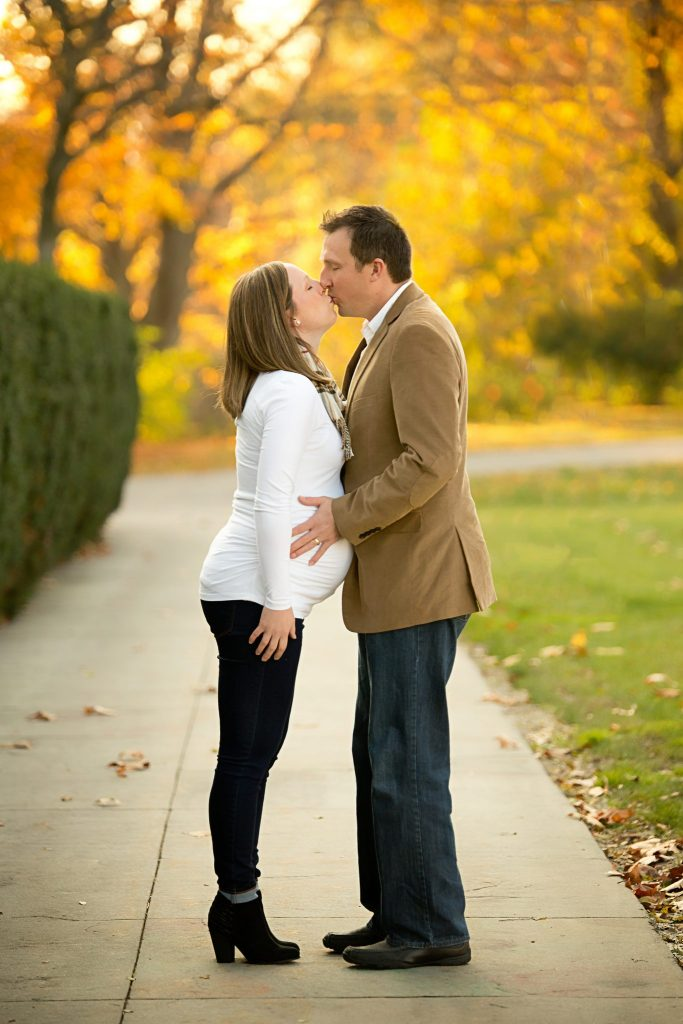 couple kissing during maternity shoot