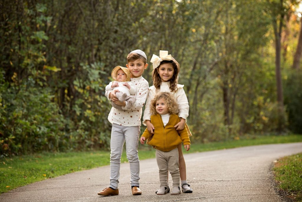 Four siblings posed on a path in Beachwood, Ohio park