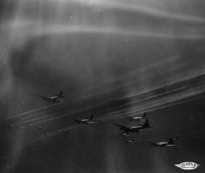A flight of 17's and the beginning of contrail formation. 069