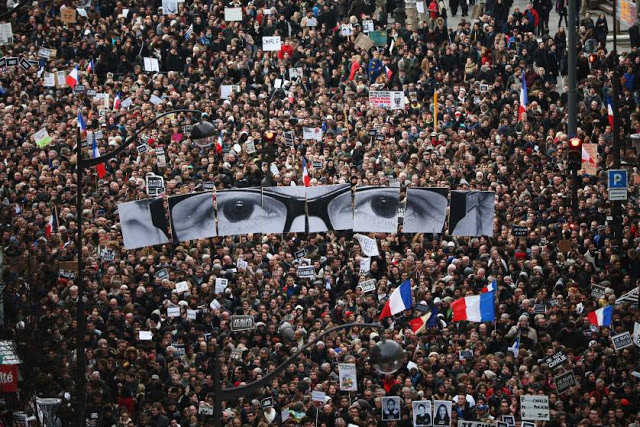 PARIS, FRANCE - JANUARY 11: Demonstrators make their way along Boulevrd Voltaire in a unity rally in Paris following the recent terrorist attacks on January 11, 2015 in Paris, France. An estimated one million people are expected to converge in central Paris for the Unity March joining in solidarity with the 17 victims of this week's terrorist attacks in the country. French President Francois Hollande will lead the march and will be joined by world leaders in a sign of unity. The terrorist atrocities started on Wednesday with the attack on the French satirical magazine Charlie Hebdo, killing 12, and ended on Friday with sieges at a printing company in Dammartin en Goele and a Kosher supermarket in Paris with four hostages and three suspects being killed. A fourth suspect, Hayat Boumeddiene, 26, escaped and is wanted in connection with the murder of a policewoman. (Photo by Christopher Furlong/Getty Images)