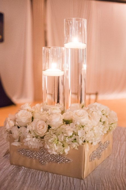 cylinder vases, candles, roses and hydrangeas