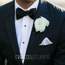 white boutonniere, suit, bowtie