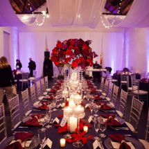 ceiling drape, red centerpiece, red florals